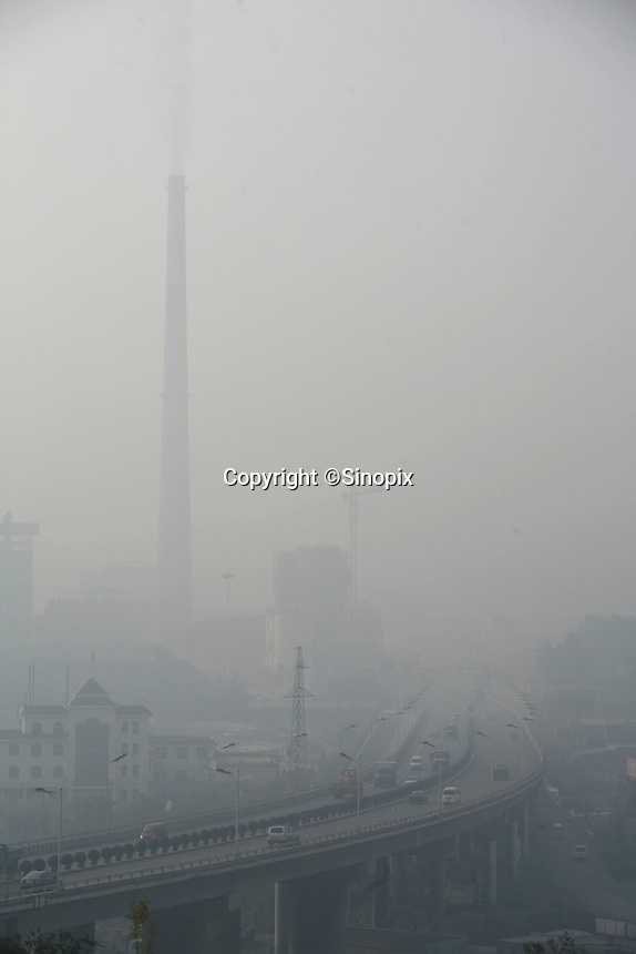 A power plant and its surrounding regions seen through a thick smog in Yangquan, Shanxi Province, China. A survey from China's State Environmental Protection Agency shows that the province of Shanxi has the top three cities with the worst air pollution in China, with the city of Yangquan coming in second as it has a very high concentration of power plants using readily available coal to supply major cities centers such as Beijing with electricity..13 Oct 2006