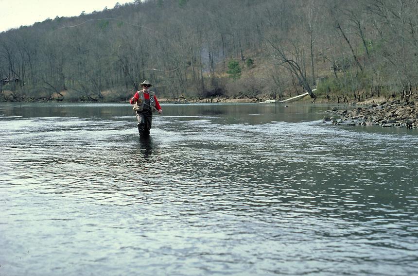 Winter fly fisherman on Little Red River near Heber Springs, Arkansas