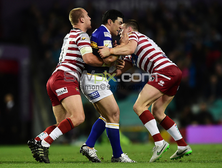 Picture by Alex Broadway/SWpix.com - 10/10/2015 - Rugby League - First Utility Super League Grand Final - Leeds Rhinos v Wigan Warriors - Old Trafford, Manchester, England - Thomas Leuluai of Leeds Rhinos is tackled by Lee Mossop and Joel Tomkins of Wigan Warriors.