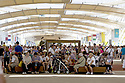 Visitors to Expo 2015 resting in a staging point along the Decumanus, the main avenue of the universal exposition, Rho-Pero, Milan, in June 2015. &copy; Carlo Cerchioli<br /> <br /> Visitatori di Expo 2015 si riposano in un punto di sosta lungo il Decumano, il viale principale dell'esposione universale, Rho-Pero, Milano, giugno 2015.