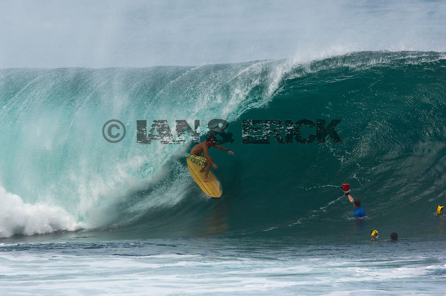 Aamion Goodwin on a Wooden board at Pipeline on The North Shore in Hawaii