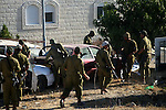Israeli soldiers look for three missing Israeli teens, feared abducted in the West Bank on June 12, in the town of Halhul near the West Bank city of Hebron on June 23, 2014. Israel has arrested more than 350 Palestinians, most affiliated with the Islamic militant Hamas, and raided some 1,600 locations. Israel has blamed the kidnappings on Hamas, which has praised the act, but not claimed responsibility. Photo by Mamoun Wazwaz