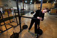 NWA Media/ J.T. Wampler - Syard Evans practices for a Strongman Competition while working out at CrossFit Fayetteville Dec. 27, 2014.