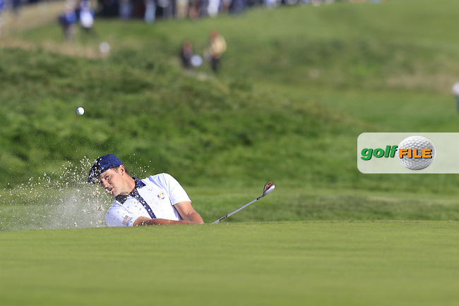 Bryson Dechambeau (Team USA) chips from a bunker at the 9th green during Saturday's Foursomes Matches at the 2018 Ryder Cup 2018, Le Golf National, Ile-de-France, France. 29/09/2018.<br /> Picture Eoin Clarke / Golffile.ie<br /> <br /> All photo usage must carry mandatory copyright credit (© Golffile | Eoin Clarke)