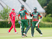 ICC World T20 Qualifier - GROUP B MATCH - CANADA V KENYA at Watsonians CC, Edinburgh - Kenya's Maurice Ouma celebrates victory with Man of the Match Irfan Karim — credit @ICC/Donald MacLeod - 10.07.15 - 07702 319 738 -clanmacleod@btinternet.com - www.donald-macleod.com