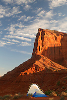 A visitor enjoys the view from camp of Monument Valley Navajo Tribal Park, Arizona.  (model released