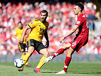 Liverpool's Trent Alexander-Arnold threads a pass despite the attentions of Wolverhampton Wanderers' Jonathan Castro Otto<br /> <br /> Photographer Rich Linley/CameraSport<br /> <br /> The Premier League - Liverpool v Wolverhampton Wanderers - Sunday 12th May 2019 - Anfield - Liverpool<br /> <br /> World Copyright © 2019 CameraSport. All rights reserved. 43 Linden Ave. Countesthorpe. Leicester. England. LE8 5PG - Tel: +44 (0) 116 277 4147 - admin@camerasport.com - www.camerasport.com
