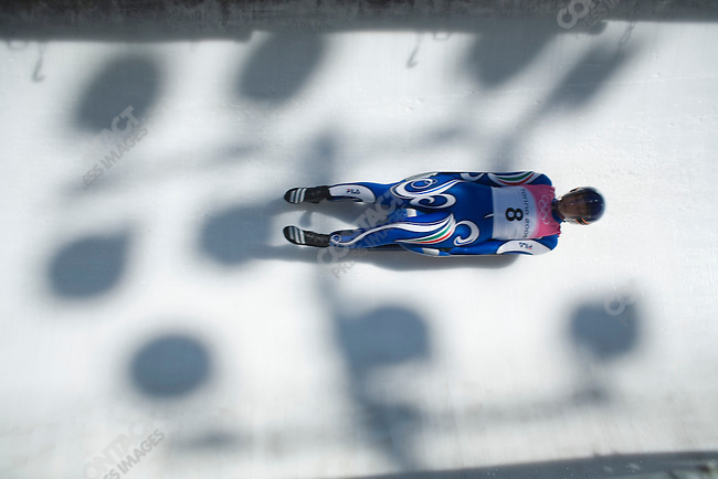 An Italian luge rider on a run during the women's practice luge runs at the Cesana Pariol venue before the start of the 2006 Winter Olympics. Torino, Italy, February 10, 2006. ..2006 ©ÊKenneth JARECKE (CONTACT PRESS IMAGES)
