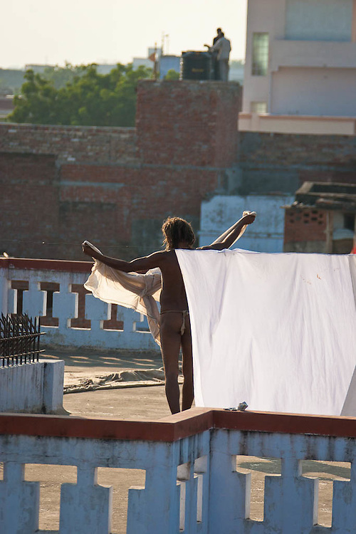 Yogi in Varanassi, India, holding his only belongings, a piece of cloth while he performs his daily routines.