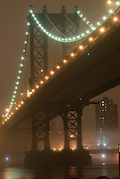 AVAILABLE FROM JEFF AS A FINE ART PRINT.<br /> <br /> AVAILABLE FROM GETTY IMAGES FOR COMMERCIAL AND EDITORIAL LICENSING.  Please go to www.gettyimages.com and search for image #77184631.<br /> <br /> Manhattan Bridge and the East River Illuminated on a Foggy Night, viewed from Brooklyn, New York City, New York State, USA