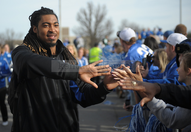 Kentucky Wildcats safety Winston Guy greets fans during the Cat Walk before the University of Kentucky football game against Tennessee at Commonwealth Stadium in Lexington, Ky., on Nov. 26, 2011. Photo by Mike Weaver | Staff