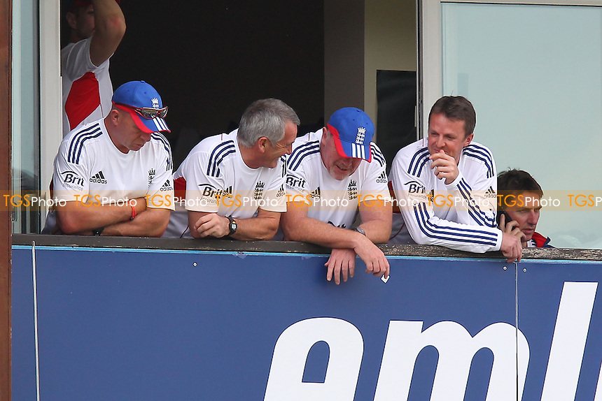 Graeme Swann of England (R) re-appears on the dressing room balcony after leaving the field earlier in the day with an arm injury - Essex CCC vs England - LV Challenge Match at the Essex County Ground, Chelmsford - 01/07/13 - MANDATORY CREDIT: Gavin Ellis/TGSPHOTO - Self billing applies where appropriate - 0845 094 6026 - contact@tgsphoto.co.uk - NO UNPAID USE