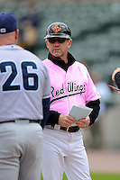 Rochester Red Wings manager Gene Glynn #8 exchanges lineup cards with Chris Tremie #26 before a game against the Columbus Clippers on May 12, 2013 at Frontier Field in Rochester, New York.  Rochester defeated Columbus 5-4 wearing special pink jerseys for Mother's Day.  (Mike Janes/Four Seam Images)