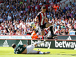 Enda Stevens of Sheffield Utd  leaps over Henrik Dalsgaard of Brentford during the English Championship League match at Bramall Lane Stadium, Sheffield. Picture date: August 5th 2017. Pic credit should read: Simon Bellis/Sportimage
