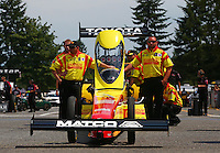 Aug. 2, 2014; Kent, WA, USA; Crew members with NHRA top fuel dragster driver Antron Brown during qualifying for the Northwest Nationals at Pacific Raceways. Mandatory Credit: Mark J. Rebilas-
