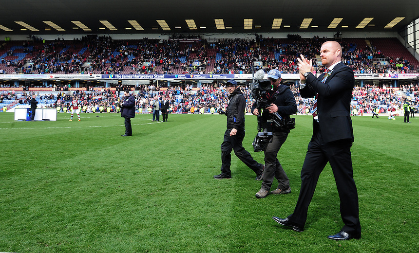 Burnley's Manager Sean Dyche celebrates his sides promotion to the Premier League<br /> <br /> Photo by Chris Vaughan/CameraSport<br /> <br /> Football - The Football League Sky Bet Championship - Burnley v Ipswich Town - Saturday 26th April 2014 - Turf Moor - Burnley<br /> <br /> &copy; CameraSport - 43 Linden Ave. Countesthorpe. Leicester. England. LE8 5PG - Tel: +44 (0) 116 277 4147 - admin@camerasport.com - www.camerasport.com