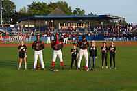 "Batavia Muckdogs Terry Bennett (33), Brayan Hernandez (41), and Ricardo Cespedes (47) stand with the ""Stars of the Game"" during the national anthem before a game against the Auburn Doubledays on August 26, 2017 at Dwyer Stadium in Batavia, New York.  Batavia defeated Auburn 5-4.  (Mike Janes/Four Seam Images)"