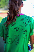A volunteer with athletes' signatures on her t-shirt on day three of the 2015 National Track and Field Championships at Newtown Park, Wellington, New Zealand on Sunday, 8 March 2015. Photo: Dave Lintott / lintottphoto.co.nz
