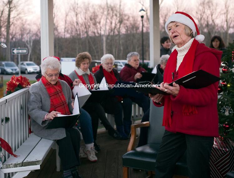 Harwinton, CT- 05 December 2015-120515CM06-Charlene Copeland and members of the Harwinton Tones from the Harwinton Senior Center sing Christmas carols during the Harwinton Hometown Holiday Celebration on Saturday.      Christopher Massa Republican-American