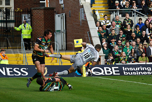 30.10.2010 Aviva Premiership Rugby Northampton Saints v Newcastle Falcons.  Newcastle's Jimmy Gopperth is collected by Northampton's Jon Clarke (standing) and Calum Clark (ground).