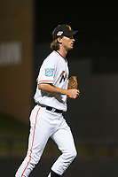 Salt River Rafters relief pitcher Tommy Eveld (33), of the Miami Marlins organization, jogs towards the pitcher's mound during an Arizona Fall League game against the Scottsdale Scorpions at Salt River Fields at Talking Stick on October 11, 2018 in Scottsdale, Arizona. Salt River defeated Scottsdale 7-6. (Zachary Lucy/Four Seam Images)