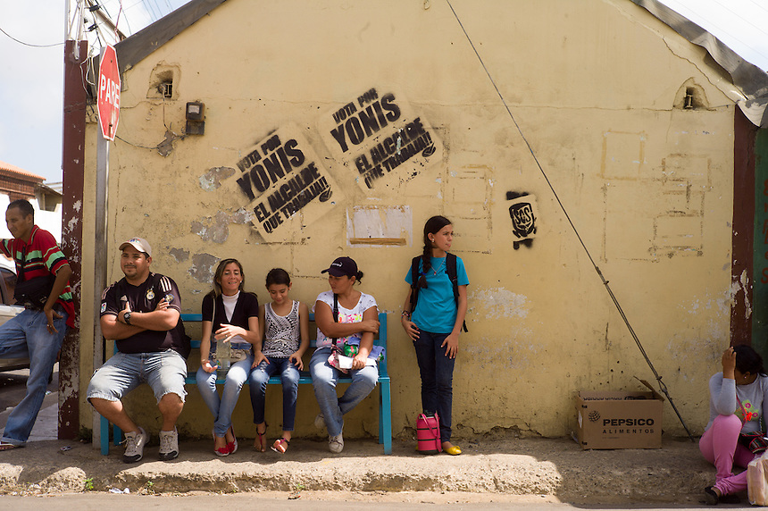 Neighbors wait for the bus in Pueblo Nuevo on Venezuela's Paraguaná Peninsula, Dec. 12, 2015. The remote desert peninsula in the Caribbean Sea lays bare the effects of Venezuela's politicized economy after 17 years under Hugo Chavez and successor Nicolas Maduro.
