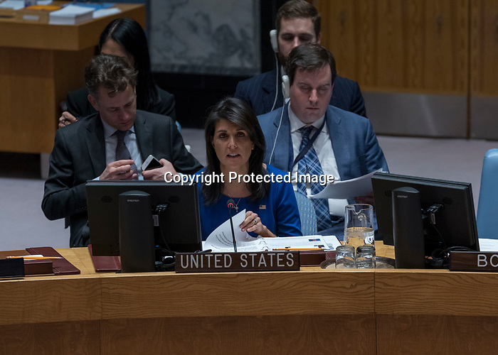 """Hajer Sharief (on screen, left), Co-founder of """"Together We Build It"""", a professional network for Libyan women, briefs the Security Council meeting on the situation in Libya.<br /> <br /> Ghassan Salamé (on screen, right), Special Representative of the Secretary-General and Head of the United Nations Support Mission in Libya (UNSMIL), also briefed the Council."""