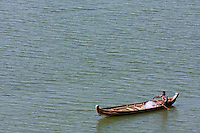 Myanmar, Burma.  Man in Boat on the Ayeyarwady (Irrawaddy) River, near Bagan.