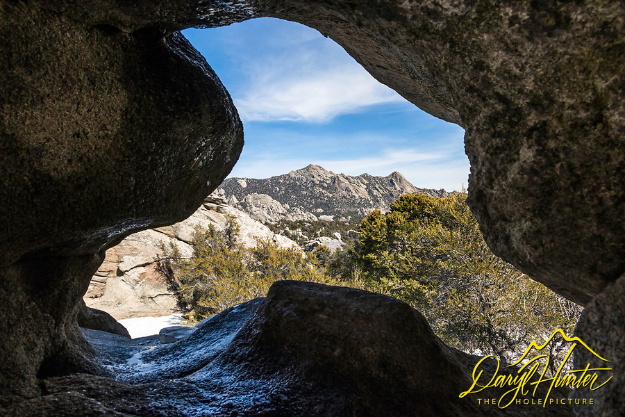 Cave opening framing the landscape of City of Rocks in southern Idaho.