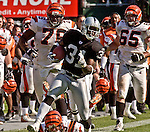 Oakland Raiders defensive back Phillip Buchanon (31) makes touchdown run after interception on Sunday, September 14, 2003, in Oakland, California. The Raiders defeated the Bengals 23-20.