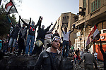 "Remi OCHLIK/IP3 -  Tahrir Square in Cairo November 23, 2011 -   Protesters take advantage of a cease fire and clean the streets Egypt's ruling military moved up the date for transferring power to a civilian government to July next year and consulted Tuesday with political parties on forming a new Cabinet. But the major concessions were immediately rejected by tens of thousands of protesters in Cairo's iconic Tahrir Square threatening a ""second revolution.  Egyptian troops moved into streets around the Interior Ministry in Cairo on Wednesday, replacing riot police who had repeatedly clashed with protesters trying to reach the building, an army officer said. Riot police withdrew inside the ministry. The removal of the widely hated police seemed to be part of efforts to calm violence that has killed more than 30 people and wounded 2,000 in Cairo and elsewhere in six days of protests targeting the ruling military council, not the army itself. The Interior Ministry, near Tahrir Square, has been the main flashpoint for clashes in which police have fired tear gas, pellets and rubber bullets at stone-throwing demonstrators."