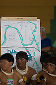 Altamira, Brazil. Encontro Xingu protest meeting about the proposed Belo Monte hydroeletric dam and other dams on the Xingu river and its tributaries. Matipu elders in front of a map showing the areas which would be flooded by the Belo Monte and other dams proposed for the Xingu River.