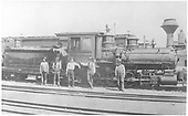Engineer's-side view of #34 &quot;Royal Gorge&quot; in a 3-rail yard with six men posing.<br /> D&amp;RG