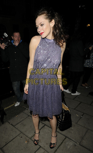 "ANNA FRIEL.Leaving the theatre after her performance in ""Breakfast at Tiffanys"" Theatre Royal Haymarket, London, England, UK, October 30th 2009..full length sleeveless grey gray dress black sandals ankle strap shoes silver beaded bag purple lace .CAP/CAN.©Can Nguyen/Capital Pictures"