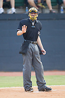 Home plate umpire Charlie Tierney indicates he needs four baseballs during an Appalachian League game between the Pulaski Mariners and the Bristol White Sox at Boyce Cox Field August 28, 2010, in Bristol, Tennessee.  Photo by Brian Westerholt / Four Seam Images