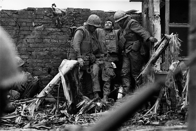 American marine being supported after having been shot in both legs during the Têt offensive, Battle of Hué, Vietnam, February 1968