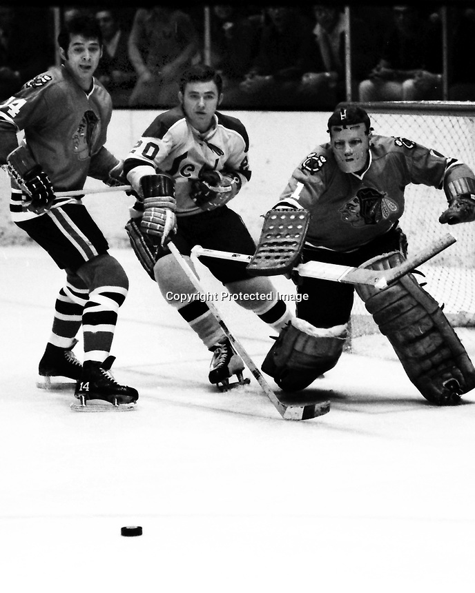 Seals vs Chicago Black Hawks 1970, Ernie Hickey, with Hawks Bryan Campbell and goalie Gerry Dejardins. (photo by Ron Riesterer)