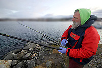 BNPS.co.uk (01202 558833)<br /> Pic: DaveWoodBrignall/BNPS<br /> <br /> Dave wrestles with the line...<br /> <br /> A British angler struck gold when he caught a record rose fish.<br /> <br /> The unusual specimen, that looks more like giant gold fish, was caught by Dave Wood-Brignall during a sea fishing trip to Bodo, Norway.<br /> <br /> It weighed 4lbs 10ozs, making it a European record for the vivid specimen that is also known as an Atlantic redfish.