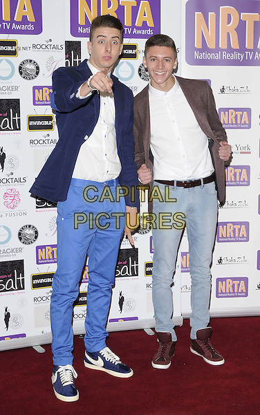 Twist & Pulse.Reality TV Awards at the Porchester Hall, London, England..August 30th 2012.full length shirt white blue jeans denim brown suit jacket sneakers trainers hand finger pointing Ashley Glazebrook Glen Murphy.CAP/CAN.©Can Nguyen/Capital Pictures.