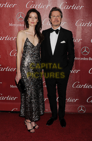 PALM SPRINGS, CA- JANUARY 04: Actor Gary Oldman (R) and Alexandra Edenborough arrive at the 25th Annual Palm Springs International Film Festival Awards Gala at Palm Springs Convention Center on January 4, 2014 in Palm Springs, California.<br /> CAP/ROT/TM<br /> &copy;Tony Michaels/Roth Stock/Capital Pictures