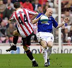 Everton's Andy Johnson catches the ball full on in the face from Sunderland's Jonny Evans. during the Premier League match at the Stadium of Light, Sunderland. Picture date 9th March 2008. Picture credit should read: Richard Lee/Sportimage