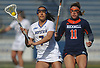 Alyssa Parrella #7 of Hofstra University, left, makes a pass during an NCAA women's lacrosse game against Bucknell at Shuart Stadium in Hempstead, NY on Saturday, Feb. 17, 2018. Hofstra cruised to a 13-1 win. Parrella tallied four goals and an assist.
