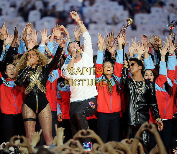 SAN FRANCISCO, CA - FEBRUARY 7: Beyonce, Chris Martin of Coldplay, and Bruno Mars perform during the Pepsi Halftime show at Super Bowl 50 at Levi's Stadium on February 7, 2016 in Santa Clara, California. <br /> CAP/MPIFM<br /> &copy;MPIFM/Capital Pictures