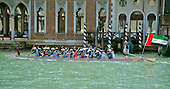 "Rowers from the United Arab Emirates (UAE) participate in the 42nd Vogalonga regatta on the Grand Canal near the the Basilica della Salute in Venice, Italy on Sunday, May 15, 2016.  The Vogalonga, a non-competitive recreational sporting event for amateur athletes, is part of the annual ""Venice International Dragon Boat Festival.""  The Grand Canal is closed to motor-driven boats during the event.<br /> Credit: Ron Sachs / CNP"