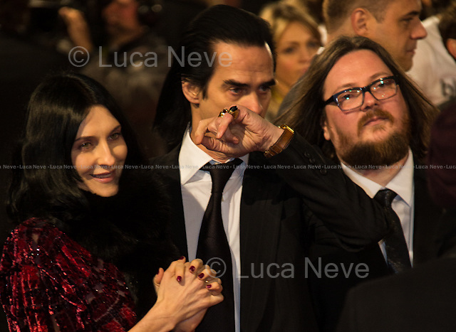 Nick Cave (Musician) and his wife Susie Bick (Model).<br /> <br /> London, 08/02/2015. Red Carpet of the 2015 EE BAFTA (British Academy of Film and Television Arts) Awards Ceremony, held at the Royal Opera House in London.