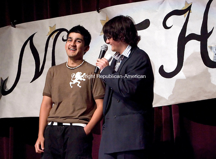 THOMASTON, CT- 08 MAY 2008- 050808JT09-<br /> Nick Guertin, right, master of ceremonies for the annual Mr. THS pageant at Thomaston High School, makes a joke about fellow physics classmate and Mr. THS contestant Massoud Salehi during the casual category of the event at the school on Thursday. The event was sponsored by the student council and money raised will fund student scholarships.<br /> Josalee Thrift / Republican-American