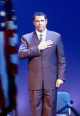 "Chantilly, VA - December 11, 2003 -- Actor John Travolta introduces a slide show and aviation pioneers as part of the ""Legacy of Flight"" during the dedication of the Steven F. Udvar-Hazy Center  of the National Air and Space Museum in Chantilly, Virginia on December 11, 2003.  Travolta is an accomplished jet flyer and owns and pilots a Boeing 707 jetliner..Credit: Ron Sachs / CNP.(RESTRICTION: NO New York or New Jersey Newspapers or newspapers within a 75 mile radius of New York City)"