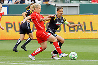 Shannon Boxx #10 of the Los Angeles Sol battles Sonia Bompastor of the Washington Freedom for control of the ball during their inaugural match at Home Depot Center on March 29, 2009 in Carson, California.