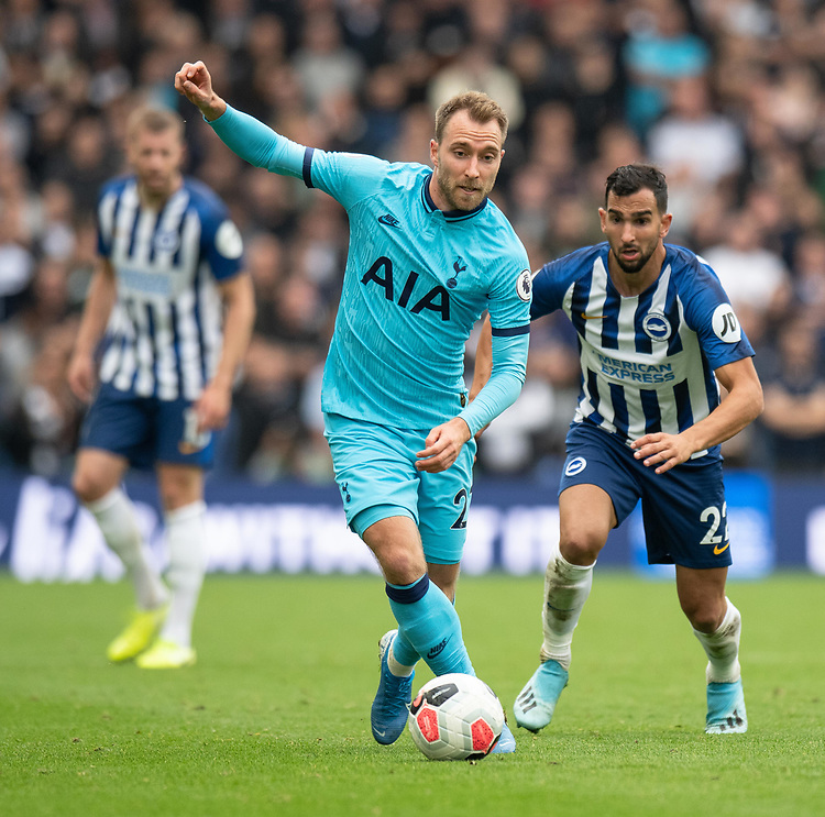 Tottenham Hotspur's Christian Eriksen (left) under pressure from Brighton & Hove Albion's Martin Montoya (right) <br /> <br /> Photographer David Horton/CameraSport<br /> <br /> The Premier League - Brighton and Hove Albion v Tottenham Hotspur - Saturday 5th October 2019 - The Amex Stadium - Brighton<br /> <br /> World Copyright © 2019 CameraSport. All rights reserved. 43 Linden Ave. Countesthorpe. Leicester. England. LE8 5PG - Tel: +44 (0) 116 277 4147 - admin@camerasport.com - www.camerasport.com