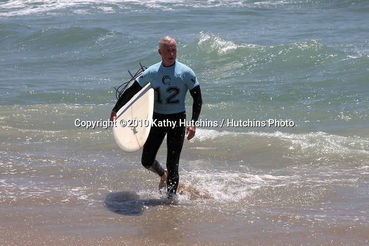 John Slattery.participates in the 3rd Annual Project SOS: SURF 24 - Day 1.Huntington  Beach Pier.Huntington Beach, CA.June 19, 2010.©2010 Kathy Hutchins / Hutchins Photo..